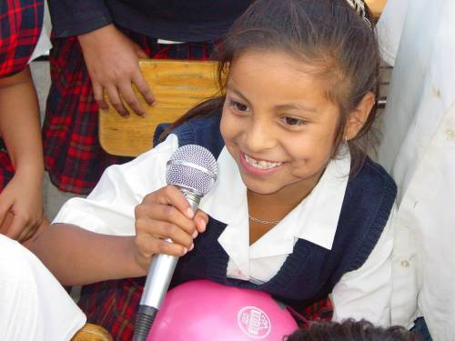 A young girl talks about teen pregnancy at an elementary school following a play about teen pregnancy prevention. © 2006 Enriqueta Valdez-Curiel, Courtesy of Photoshare