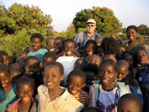 A group of children with a photographer in Zambia. © 2004 J.E. Jack, Courtesy of Photoshare
