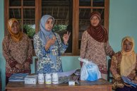 Indonesian midwife providing family planning education