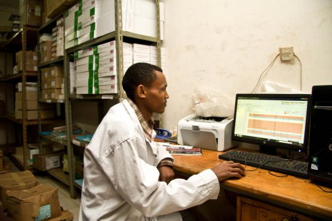 A pharmacy technician in the Amhara Region, Ethiopia, uses a computer to monitor medicine stock. © 2013 SC4CCM/JSI, Courtesy of Photoshare