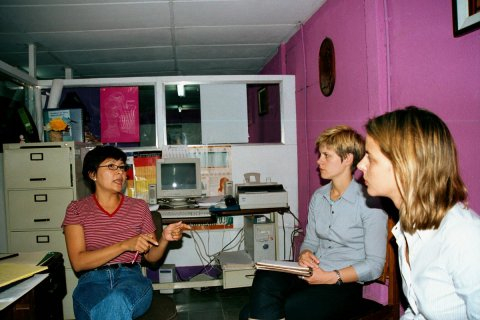 In Managua, Nicaragua, a representative from Ixchen discusses diverse aspects of the Reproductive Health/Emergency Contraception (RH/EC) Project with Jolene Beitz from PATH and Laura Murray from PRIME II/Intrah. © 2002 Alfredo L. Fort, Courtesy of Photoshare