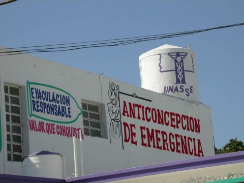 A painted sign on the side of a building in the Henequenera zone of Yucatan, Mexico advertises emergency contraception. © 2005 Arlette Gautier, Courtesy of Photoshare