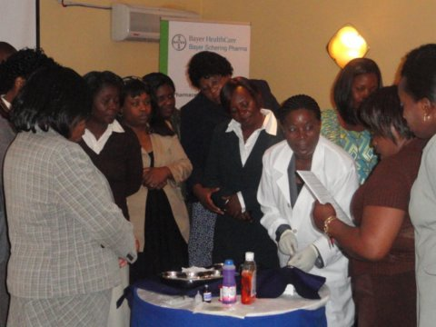 A trainer performs a demonstration for health workers during a Jadelle counseling training session in Zambia. © 2011 Annette Velleuer Bayer HealthCare, Courtesy of Photoshare