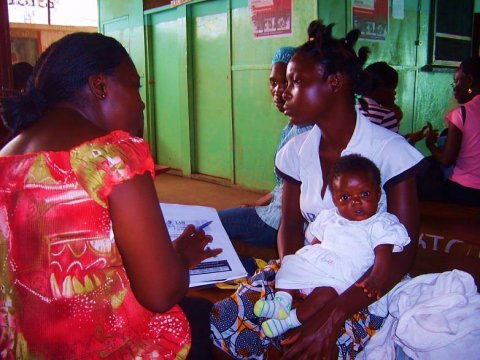 Woman with baby receiving counseling in Liberia. Credit: Holly Blanchard