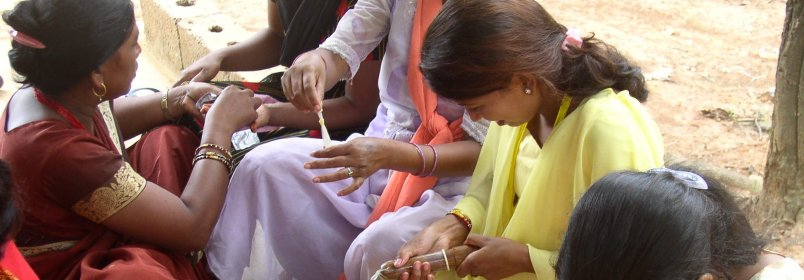 Women in Nepal receive a condom demonstration. © 2004 Rebecca Callahan, Courtesy of Photoshare